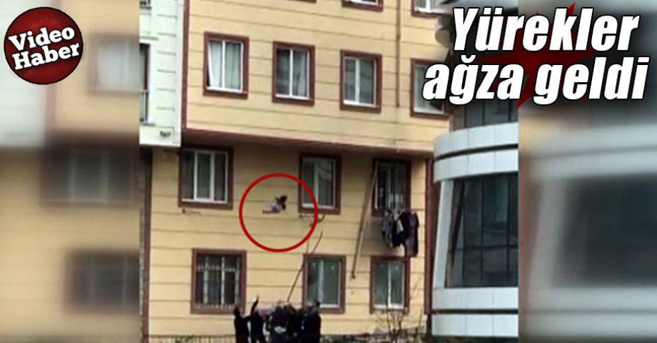 Camdan düşen çocuğu vatandaşlar havada yakaladı