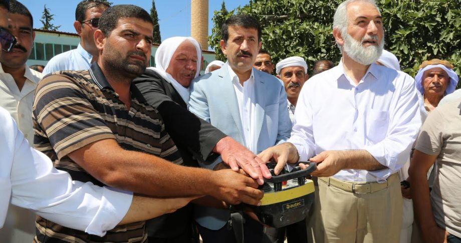 Mehmet Ekinci,  Kur'an Kursu Binası'nın temelini attı.